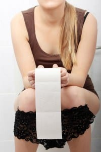 bigstock_Woman_sitting_on_a_toilet_hold_13037114